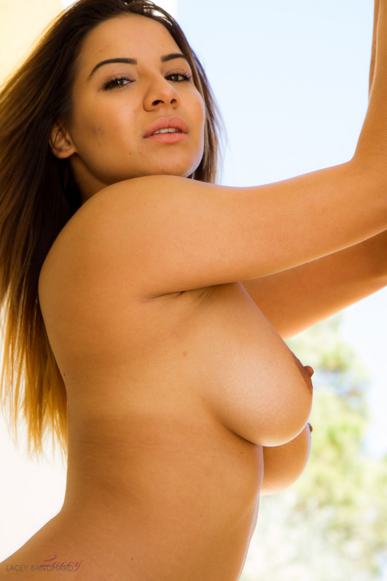 lacey banghard strips out of her grey knitted dress