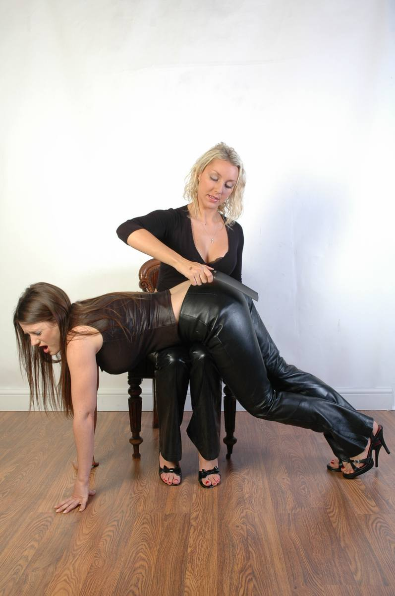 Spank in leather pants and