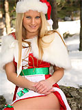 gorgeous santa blonde posing outdoors in x-mas outfits