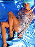 exotic blonde milf in fishnet sequin top showing her perfect legs in tan nylons