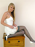 Amazing blonde Alexis in white dress, dark-grey stockings and white high heels