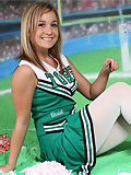 Hot sporty girl in cheerleaders uniform and shiny white tights