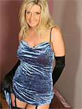 Busty Alexandra in a stunning blue evening dress, black lingerie and stockings