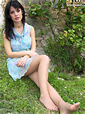 cute brunette showing her nyloned feet outdoors