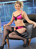 Nikki F teasing in pink satin lingerie and black stockings with garter belt