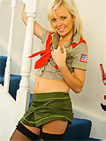 Sweet blonde girl teasing in scout uniform