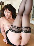 Leggy british milf in sexy black stockings
