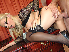 Leggy blonde secretary in black stockings fucking